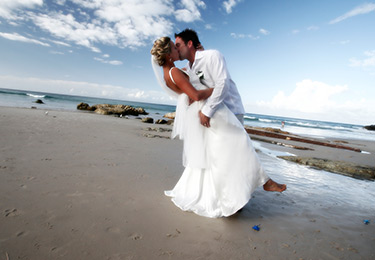 Couple kissing on beach